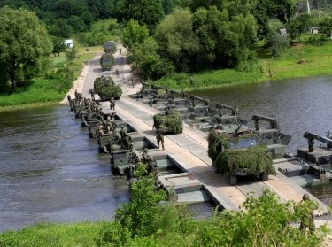 German troops cross the Neris River during the 2017 Iron Wolf exercise in Stasenai, Lithuania, June 20, 2017