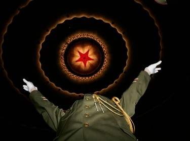 A Chinese military band conductor prepares to perform before the opening ceremony of the National People's Congress at the Great Hall of the People in Beijing March 5, 2007