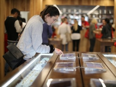 A customer browses screens displaying recreational marijuana products at the MedMen store in West Hollywood, California, January 2, 2018