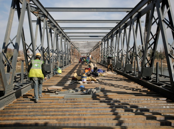 Workers repair a bridge in Mosul, Iraq, January 28, 2018