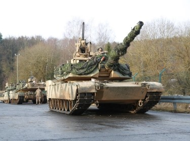 An M1A1 Abrams tank from Charlie Company, 1st Battalion, 18th Infantry Regiment, 2nd Armored Brigade Combat Team, 1st Infantry Division rolls out of a motor pool during a convoy operation during exercise Allied Spirit VIII at the U.S. Army's Joint Multinational Readiness Center in Hohenfels, Germany, Jan. 25, 2018