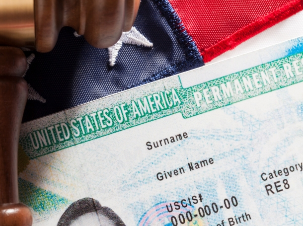 U.S. Permanent Resident ID (green card) with a gavel and an American flag