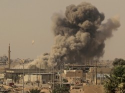 Smoke rises after an airstrike during fighting between the Syrian Democratic Forces and Islamic State militants, Raqqa, Syria, August 15, 2017