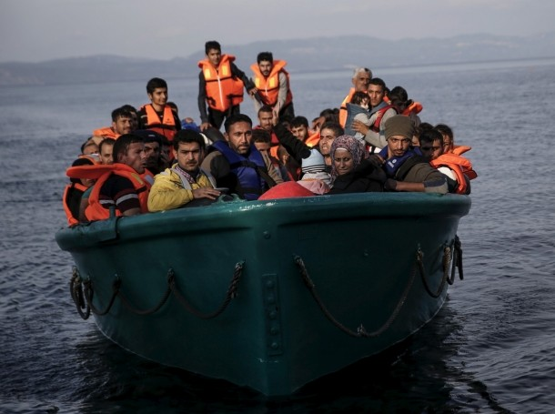 Refugees and migrants arrive on an overcrowded boat on the Greek island of Lesbos, November 10, 2015