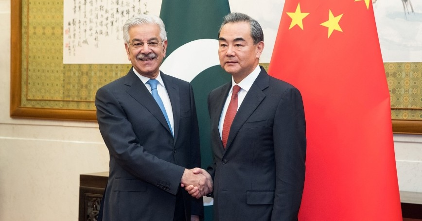 Chinese Foreign Minister Wang Yi (R) shakes hands with Pakistan Foreign Minister Khawaja Muhammad Asif (L) at Diaoyutai State Guesthouse on September 8, 2017 in Beijing, China