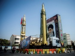 A display featuring missiles and a portrait of Iran's Supreme Leader Ayatollah Ali Khamenei is seen at Baharestan Square in Tehran, Iran, September 27, 2017