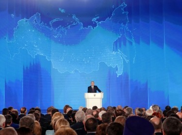 Russian President Vladimir Putin addresses the Federal Assembly in Moscow, Russia March 1, 2018