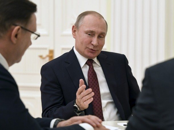 Russian President Vladimir Putin meets with co-chairs of his campaign office at the Kremlin in Moscow, Russia, March 19, 2018