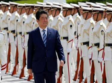 Japan's Prime Minister Shinzo Abe reviews the honor guard before a meeting with Japan Self-Defense Force's senior members at the Defense Ministry in Tokyo, Japan, September 11, 2017