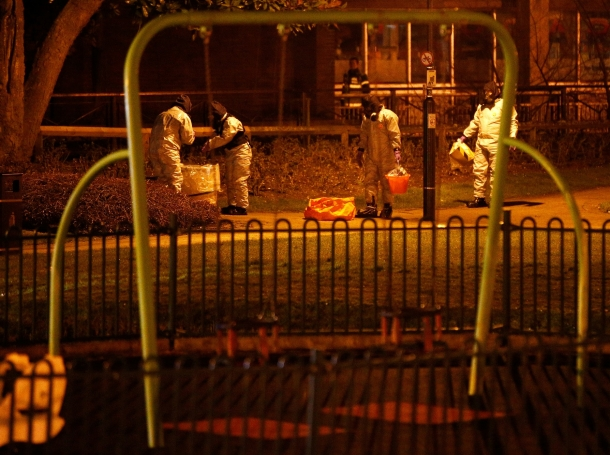 Emergency services staff work next to a children's play area near the bench where former Russian intelligence officer Sergei Skripal and his daughter Yulia were found poisoned in Salisbury, UK, March 13, 2018