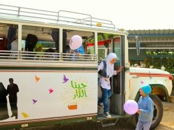 Girls exit ABAAD's Jina al-Dar bus in Lebanon
