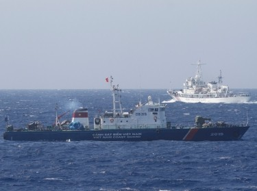 A Chinese Coast Guard ship (top) and a Vietnam Marine Guard ship in the South China Sea, about 130 miles away from Vietnam, May 14, 2014