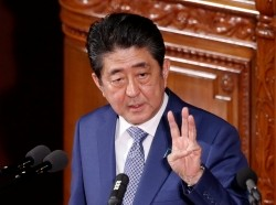Japan's Prime Minister Shinzo Abe speaks at an opening of a new session of parliament in Tokyo, January 22, 2018