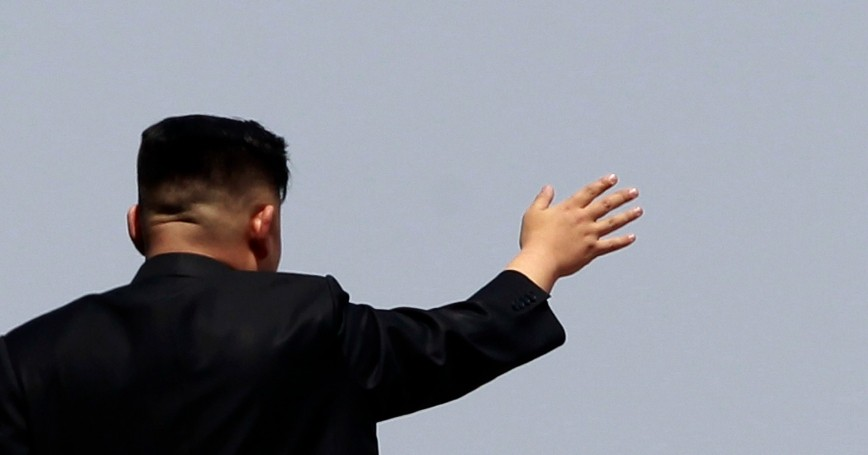 North Korean leader Kim Jong Un waves to the crowd during a military parade in Pyongyang, April 15, 2012