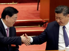 Chinese President Xi Jinping shakes hands with Zhang Dejiang after a vote on a constitutional amendment lifting presidential term limits, at the Great Hall of the People in Beijing, China, March 11, 2018