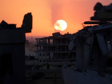 Destroyed buildings during sunset at the frontline in Raqqa, Syria, October 6, 2017