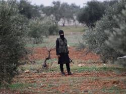 A member of al Qaeda's Nusra Front near Idlib, Syria, December 2, 2014
