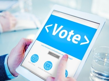 A tablet displaying a voting website