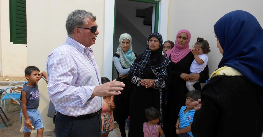 Syrian-born mayor of the local Andravida-Kyllini municipality Nampil-iosif Morant meets Syrian refugees near the town of Myrsini southwest of Athens, Greece, August 13, 2016