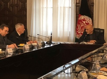 U.S. Defense Secretary James Mattis speaks with Afghan President Ashraf Ghani in Kabul, Afghanistan, March 13, 2018