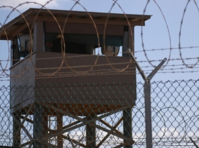 A soldier stands guard in a tower overlooking Camp Delta at Guantanamo Bay naval base, Cuba, December 31, 2009