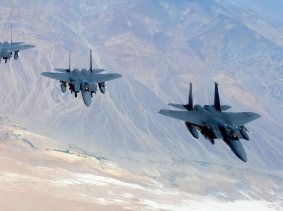 Four F-15E Strike Eagles fly in formation above the Nevada Test and Training Range June 21, 2011