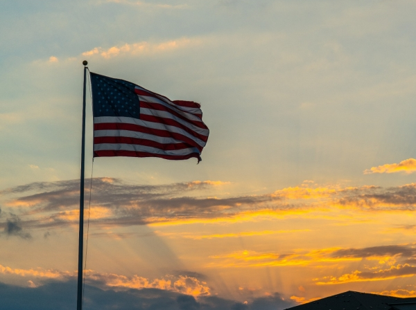 An American flag after a sunset