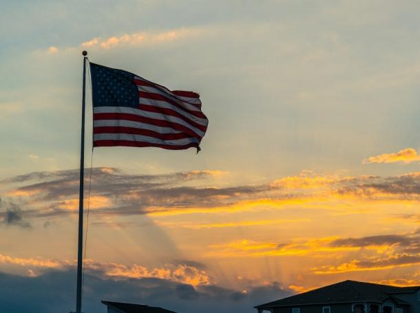 An American flag after a sunset