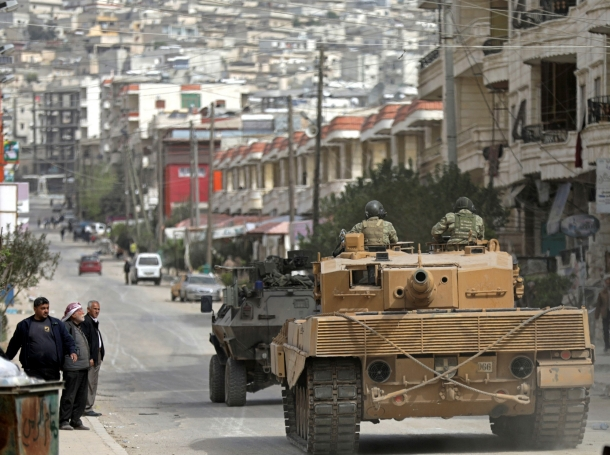 Turkish forces patrol an area in Afrin, Syria, March 22, 2018
