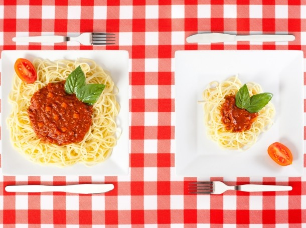 Large and small portions of pasta and sauce