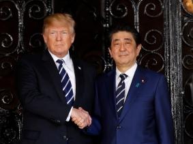 U.S. President Donald Trump greets Japan's Prime Minister Shinzo Abe prior to their bilateral meeting at Trump s Mar-a-Lago estate in Palm Beach, Florida U.S., April 17, 2018