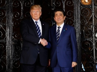 U.S. President Donald Trump greets Japan's Prime Minister Shinzo Abe prior to their bilateral meeting at Trump s Mar-a-Lago estate in Palm Beach, Florida U.S., April 17, 2018