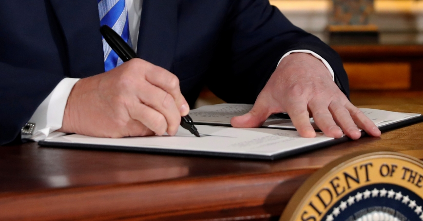 U.S. President Donald Trump signs a proclamation declaring his intention to withdraw from the JCPOA Iran nuclear agreement in the Diplomatic Room at the White House in Washington, D.C. May 8, 2018