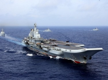China's aircraft carrier Liaoning takes part in a military drill of Chinese People's Liberation Army (PLA) Navy in the western Pacific Ocean, April 18, 2018