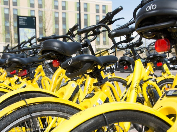 Ofo cycles lined up and ready for use at a railway station, Cambridge, UK, April 26, 2018