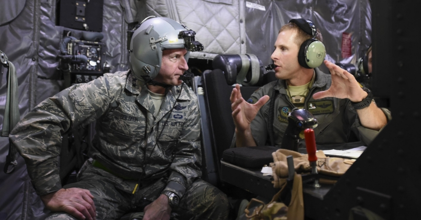 Air Force Maj. Travis Tucker, right, explains an AC-130U Spooky gunship's weapons systems to Air Force Chief of Staff Gen. David L. Goldfein during a mission orientation flight at Hurlburt Field, Florida, Oct. 19, 2016