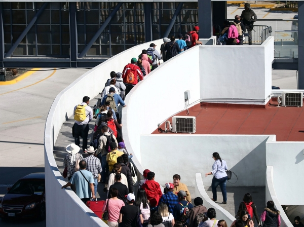 Migrants from Central America enter the United States Border and Customs facility, where they are expected to apply for asylum, in Tijuana, Mexico, May 4, 2018