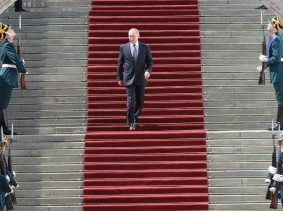 Russian President Vladimir Putin walks down the stairs after an inauguration ceremony in Cathedral Square at the Kremlin in Moscow, Russia, May 7, 2018