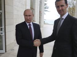 Russian President Vladimir Putin (L) shakes hands with Syrian President Bashar al-Assad in Sochi, Russia, November 20, 2017