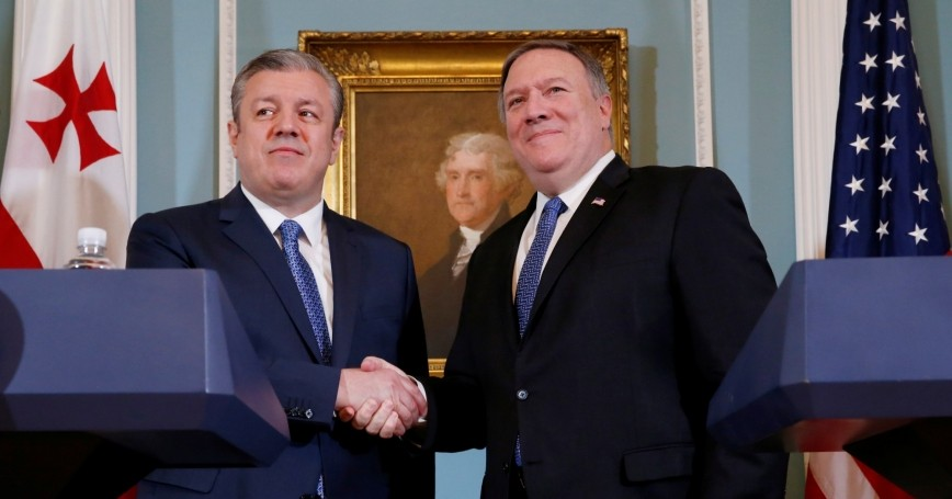 U.S. Secretary of State Mike Pompeo (right) shakes hands with Georgia's Prime Minister Giorgi Kvirikashvili at the State Department in Washington, D.C., May 21, 2018