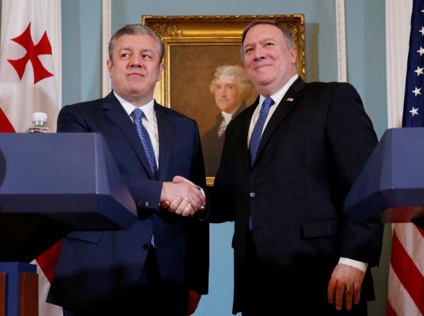 U.S. Secretary of State Mike Pompeo (right) shakes hands with Georgia's Prime Minister Giorgi Kvirikashvili at the State Department in Washington, D.C., May 21, 2018