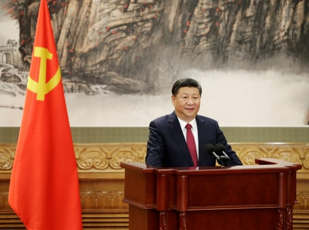 Chinese President Xi Jinping speaks as China's new Politburo Standing Committee members meet with the press at the Great Hall of the People in Beijing, China, October 25, 2017