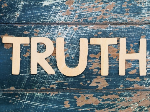 The word 'truth' written with wooden letters on a rustic surface