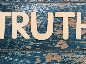 Word truth written with wooden letters on rustic surface