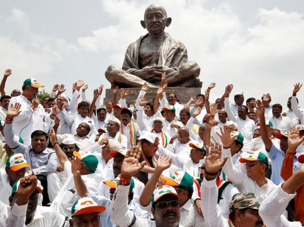Lawmakers from India's main opposition Congress party and the Janata Dal (Secular) protest against India's ruling Bharatiya Janata Party (BJP) leader B.S. Yeddyurappa's swearing-in as Chief Minister of the southern state of Karnataka, in Bengaluru, India, May 17, 2018