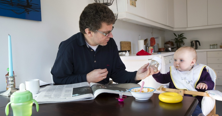 Peter Talos feeds his daughter Karin, as they spend time together during his parental leave, in Oslo, Norway, October 5, 2012