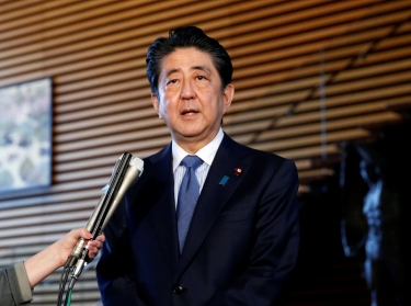Japan's Prime Minister Shinzo Abe speaks to media at his official residence in Tokyo, Japan, after the Singapore summit between the U.S. and North Korea, June 12, 2018