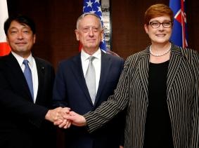 Japan's Defence Minister Itsunori Onodera, U.S. Secretary of Defence Jim Mattis, and Australia's Defence Minister Marisa Payne meet on the sidelines at the IISS Shangri-la Dialogue in Singapore, June 2, 2018