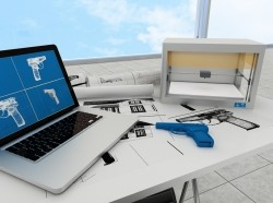A desk with 3D printing technology on top