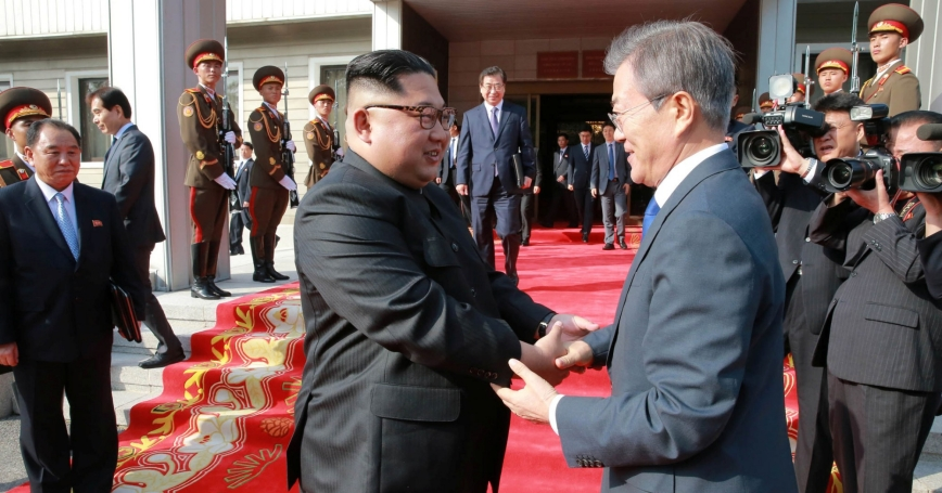 South Korean President Moon Jae-in shakes hands with North Korean leader Kim Jong-un during their summit at the truce village of Panmunjom, North Korea, May 27, 2018